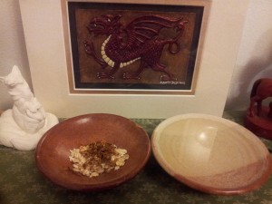 Tobacco, oats and water at the feet of my laughing  fox and welsh dragon.